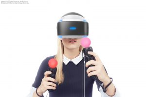 The PlayStation VR. Lights on the headset and handheld devices are tracked by a camera to simulate your movement in virtual space.